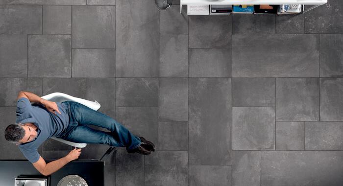 Man sitting on grey stone tiles