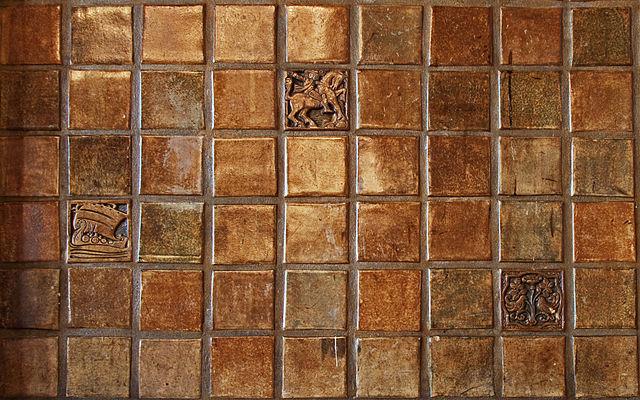 golden painted Egyptian bathroom tiles