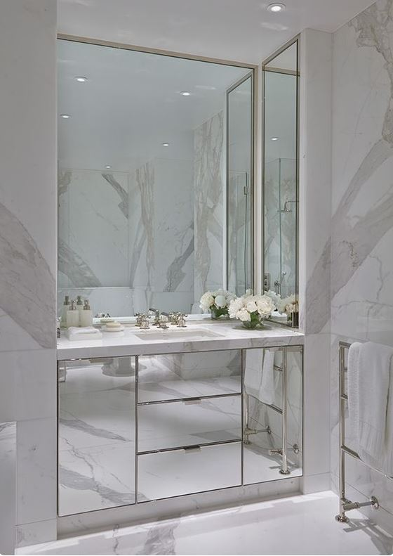 mirrored cupboards in bathroom