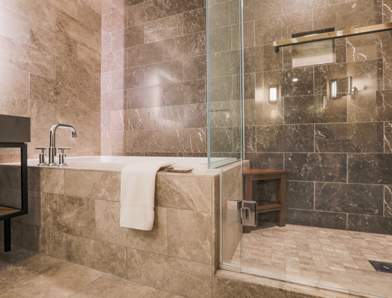 modern tiled bathroom with shower and bath