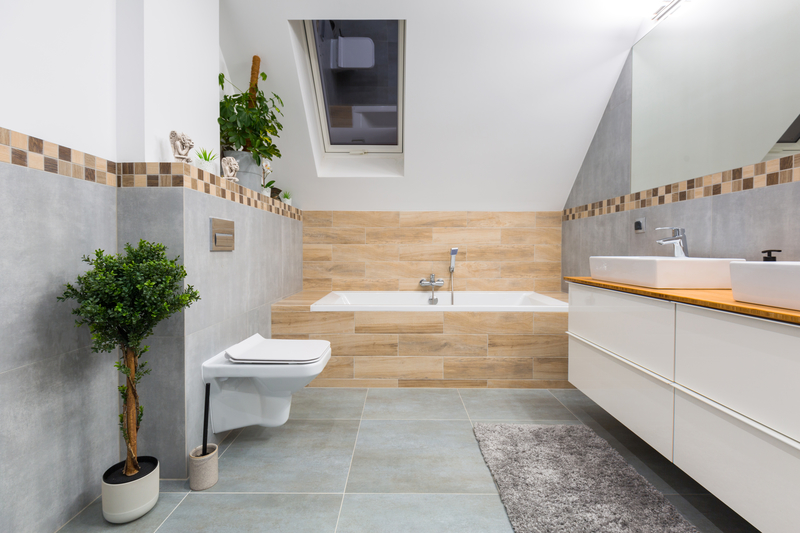 Grey tiled bathroom and natural wood