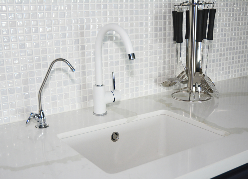 white tiled wall and white sink